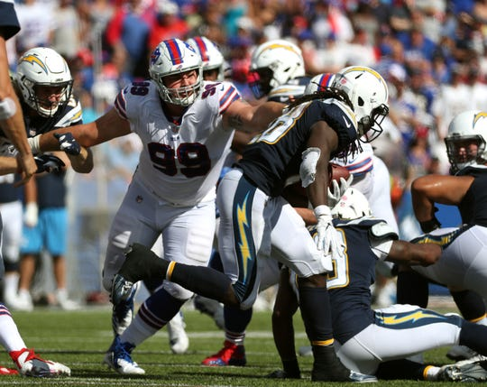 Bills rookie defensive lineman Harrison Phillips breaks through the line.