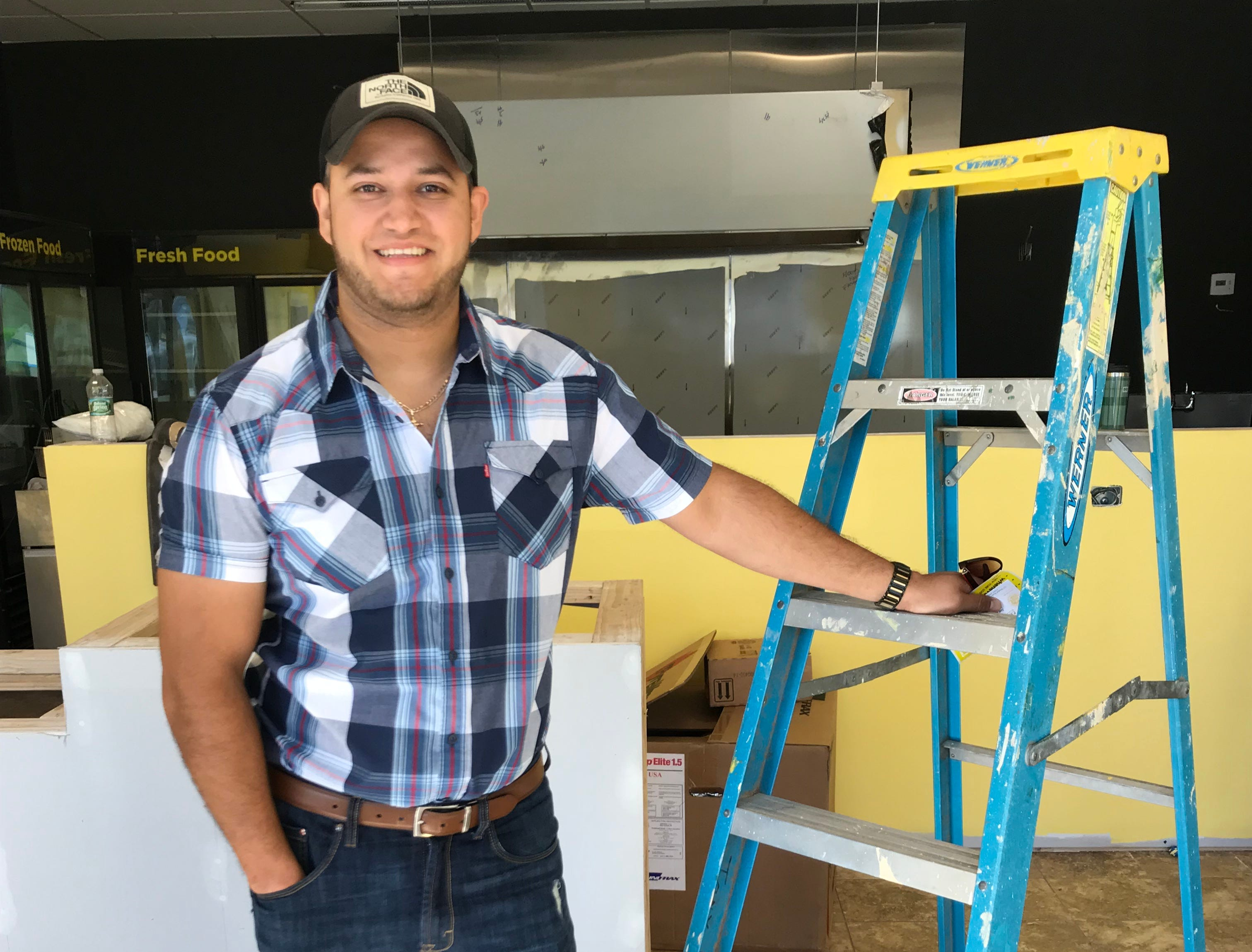 Mauricio Hernandez, a partner in Itacate, stands in the Chili location, under construction.