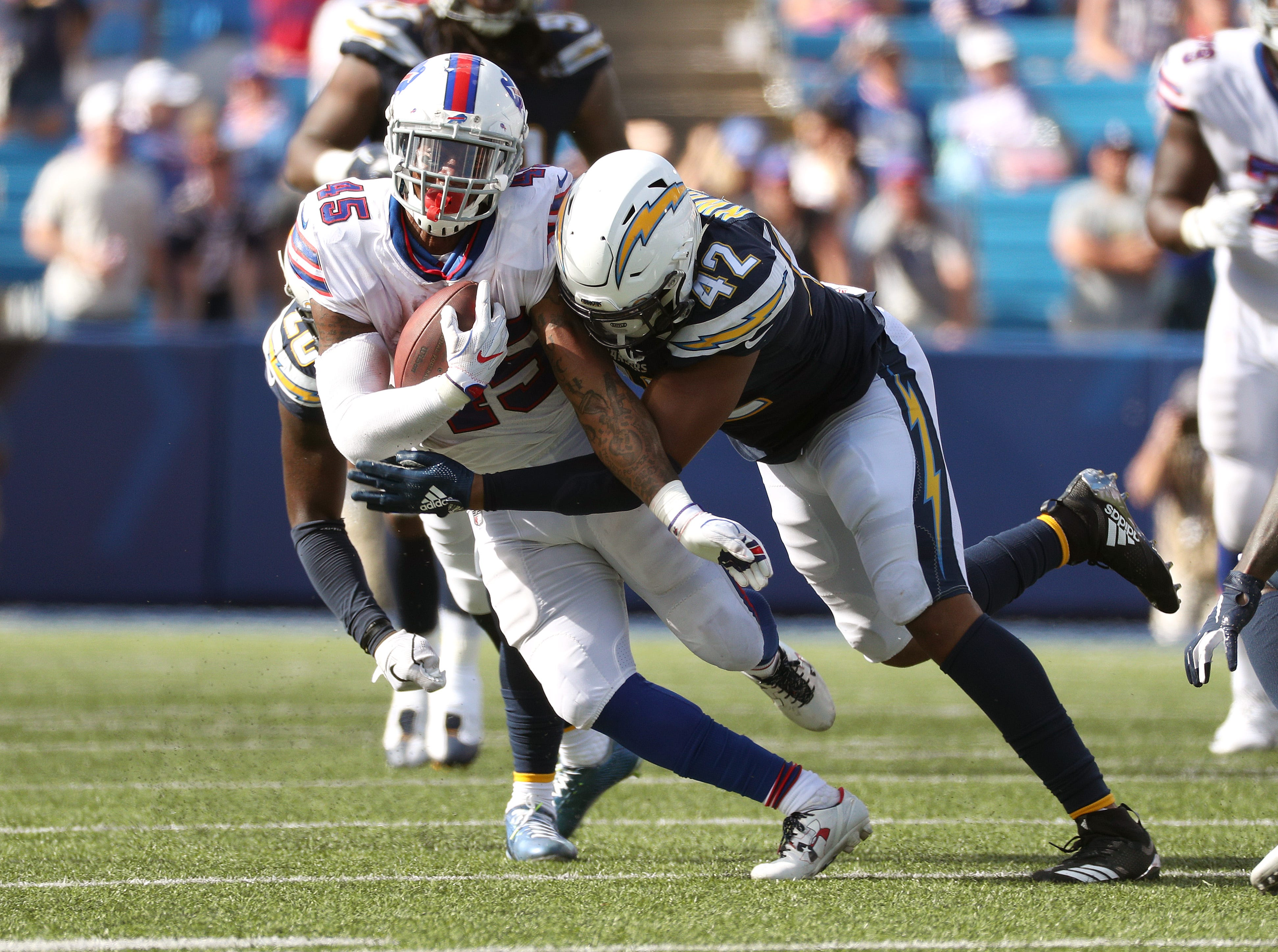 Bills running back Marcus Murphy is hit by Chargers Uchenna Nwosu.