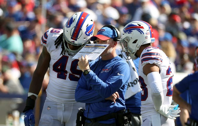 Bills head coach talks with linebacker Tremaine Edmunds and Micah Hyde during a timeout. McDermott took over making the defensive calls in the second half against Los Angeles Chargers and might be inclined to keep them for next two weeks with brutal road games at Minnesota and Green Bay.