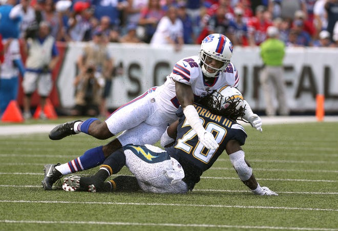 Vontae Davis makes a tackle on Chargers running back Melvin Gordon lll in the first half of Sunday's game at New Era Field.  Davis left the team at halftime and retired from football.