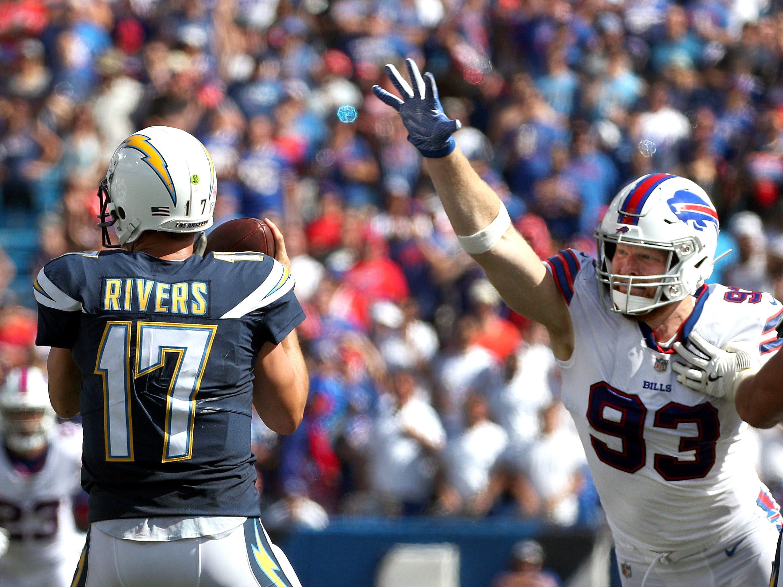Bills Trent Murphy pressures Chargers quarterback Philip Rivers.