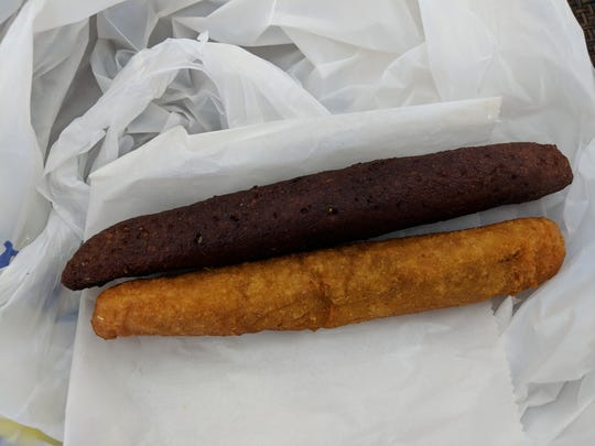 The deep-fried alcapurrias contained seasoned ground beef. One had an exterior made from banana, the other from yuca and cassava.