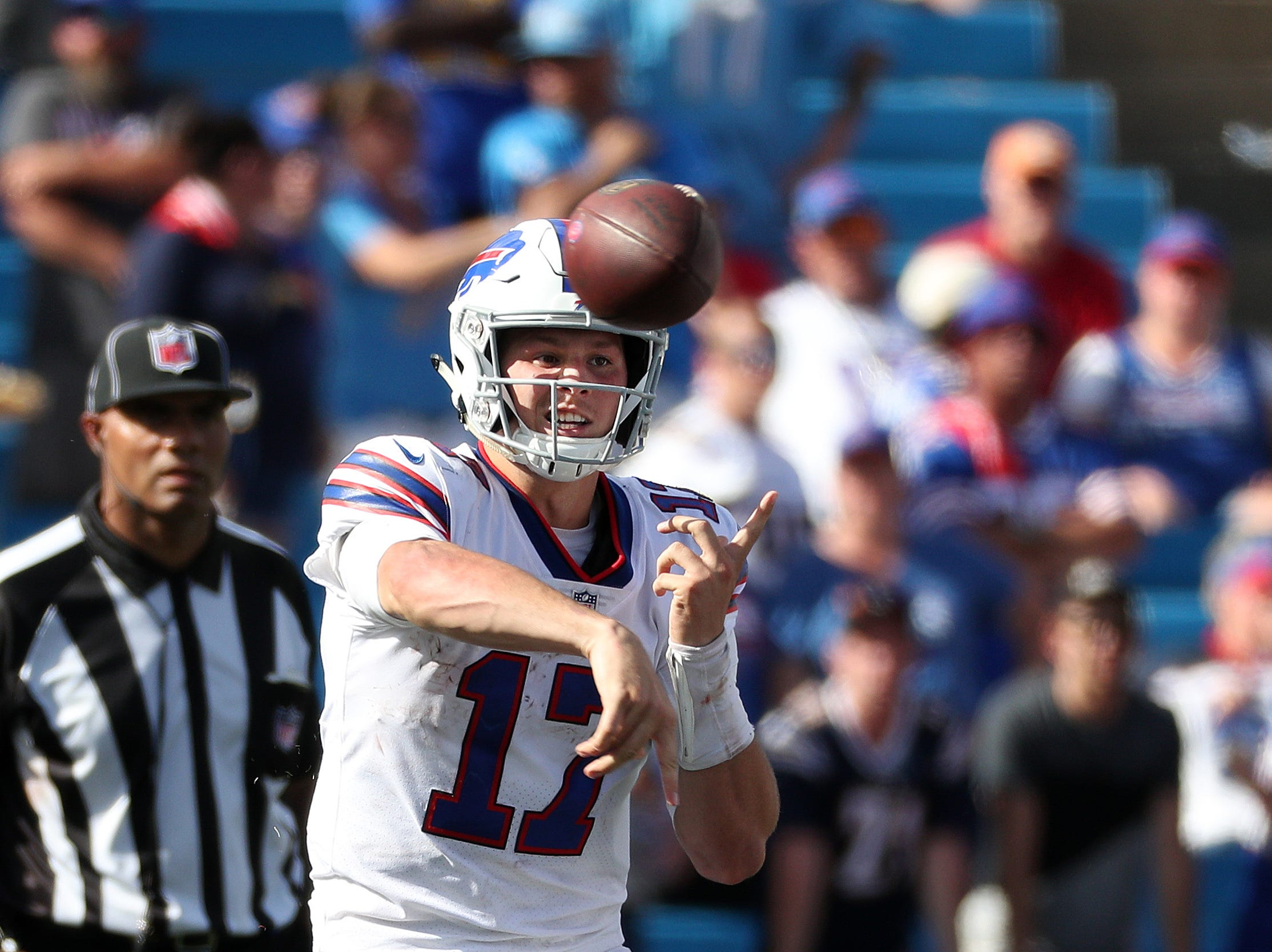 Bills quarterback Josh Allen delivers a pass over the middle.  The Bills lost 31-20 to the Chargers in his NFL debut.