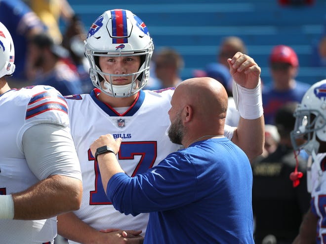 Bills rookie quarterback Josh Allen is greeted by offensive coordinator Brian Daboll before starting his first NFL game against the Chargers.