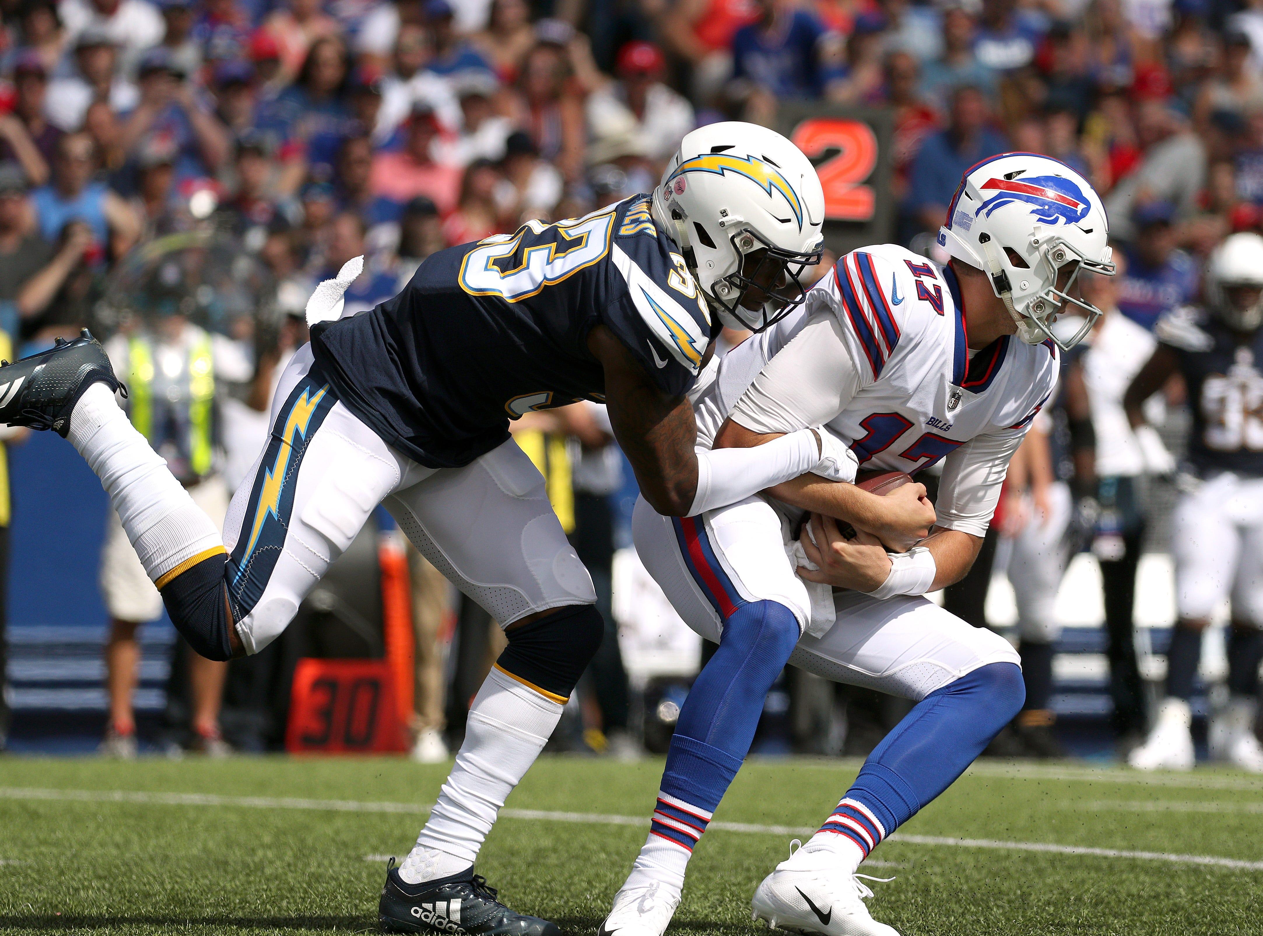 Bills quarterback Josh Allen is sacked by the Chargers' Derwin James.