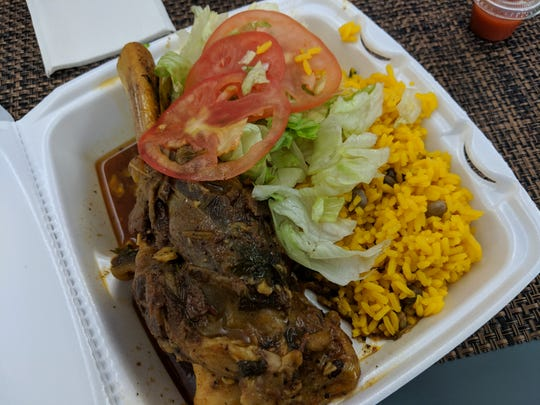 The lamb shank was tender and fragrant. Yellow rice and beans are a choice of side.