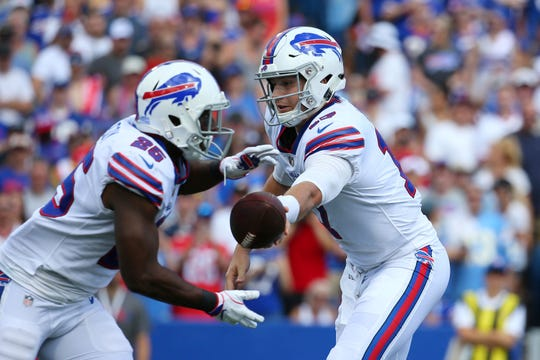Buffalo Bills quarterback Josh Allen, right, hands off to LeSean McCoy during the first half an NFL football game against the Los Angeles Chargers, Sunday, Sept. 16, 2018, in Orchard Park, N.Y. (AP Photo/Rich Barnes)