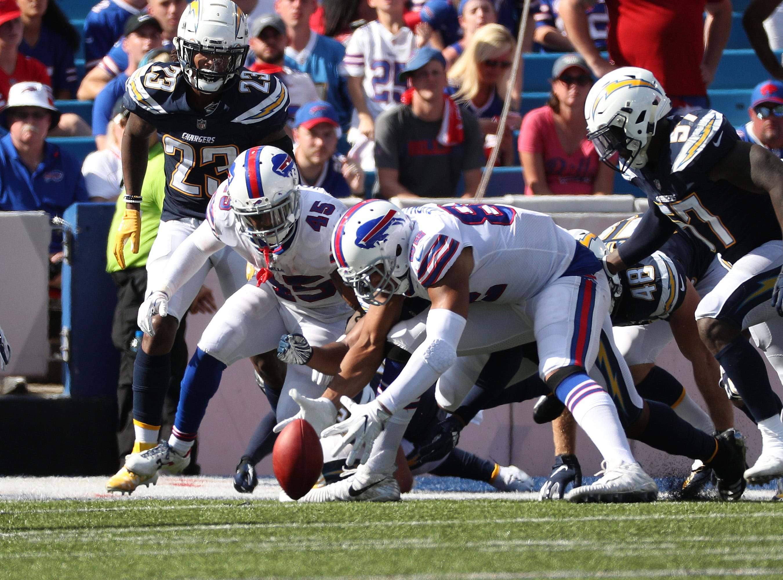 Bills Logan Thomas and Marcus Murphy recover a punt  at the one yard line.
