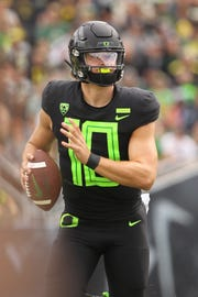 Oregon quarterback Justin Herbert (10) moves the ball against San Jose State in the first half at Autzen Stadium. Mandatory Credit: Jaime Valdez-USA TODAY Sports
