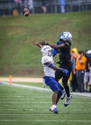 Angelo State's Keke Chism jumps up to catch a pass as Texas A&M-Kingsville approaches Saturday, Sept. 15, 2018, at LeGrand Stadium at 1st Community Credit Union Field.