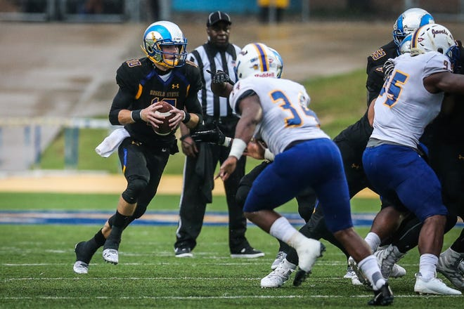 Angelo State's Payne Sullins runs the ball past Texas A&M-Kingsville Saturday, Sept. 15, 2018, at LeGrand Stadium at 1st Community Credit Union Field.