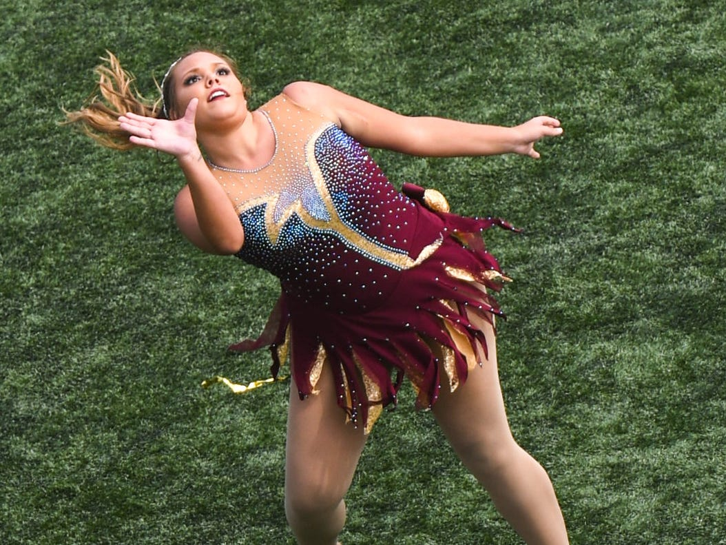 Baton twirler Hannah Winslow performs in the halftime show at the Salisbury University game against Kean on Saturday, Sept 15, 2018 at Seagull Stadium.