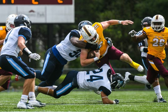 Salisbury University Quarterback Jack Lanham tries to avoid a tackle against Kean on Saturday, Sept 15, 2018 at Seagull Stadium.