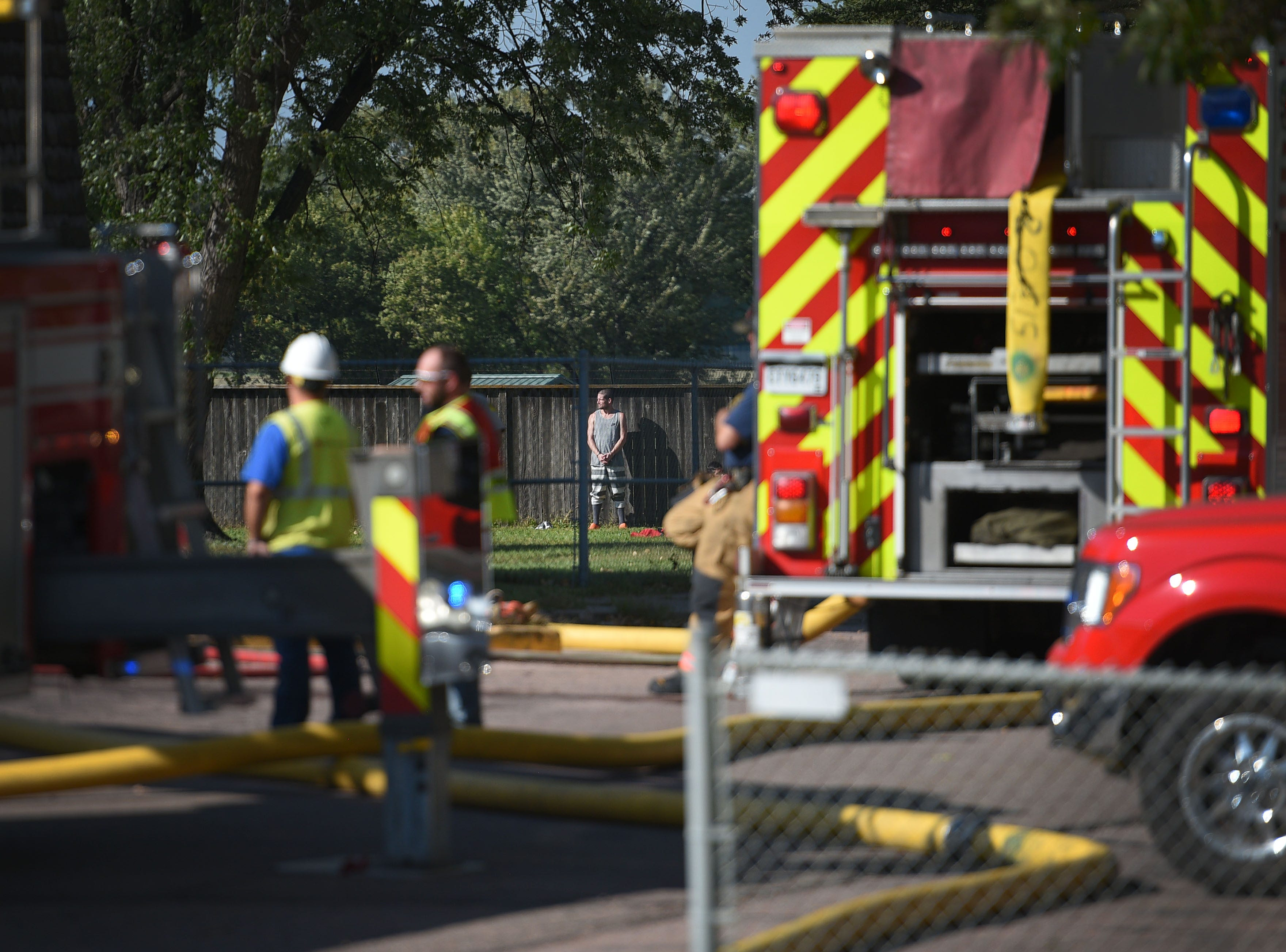 Inmates are transferred from the Minnehaha County Correction Center to the downtown jail after a fire Sunday, Sept. 16, in Sioux Falls.