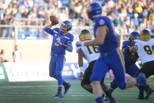SDSU's Taryn Christion throws a pass during the game against Arkansas-Pine Bluff Saturday, Sept. 15, at Dana J Dykhouse Stadium in Brookings.