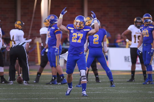 SDSU's Brandon Snyder throws his hands up to get the crowd going during the game against Arkansas-Pine Bluff Saturday, Sept. 15, at Dana J Dykhouse Stadium in Brookings.