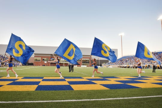 SDSU cheerleaders run the flags after a touchdown during the game against Arkansas-Pine Bluff Saturday, Sept. 15, at Dana J Dykhouse Stadium in Brookings.