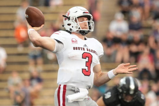 South Dakota quarterback Austin Simmons  (3) passes the ball in the first half of play against Weber State on Saturday, Sept. 15, 2018, at Stewart Stadium in Ogden.