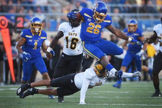 SDSU's Mikey Daniel leaps over Arkansas-Pine Bluff defense during the game Saturday, Sept. 15, at Dana J Dykhouse Stadium in Brookings.