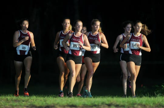 Chiles' Emily Culley (85) leads a pack of Timberwolves runners out of the woods at the Red Hills Invitational cross country meet at Elinor Klapp-Phipps Park.
