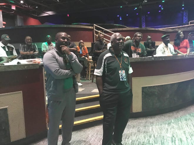 FAMU football head coach Willie Simmons (left) and Rudy Hubbard listen to speeches during the reunion to honor the 1978 Division I-AA national championship team at The Moon on Sept. 14, 2018.