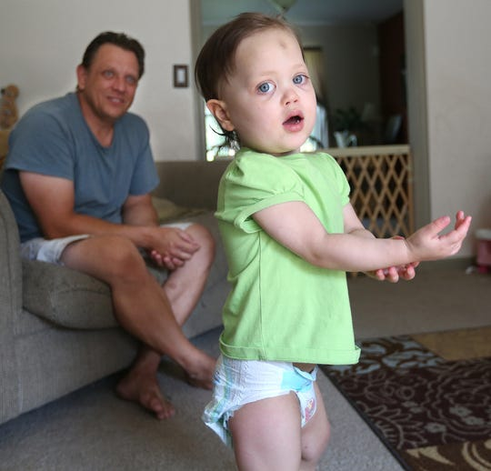 Tom Novak  and daughter Chloe Novak at age 3 in 2013. Chloe received a heart transplant at age 2.