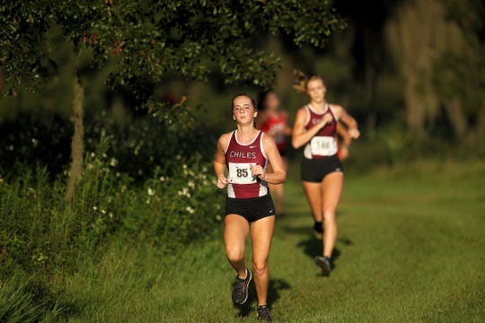 Chiles' Emily Culley runs to the finish of the Red Hills Invitational cross country meet at Elinor Klapp-Phipps Park.