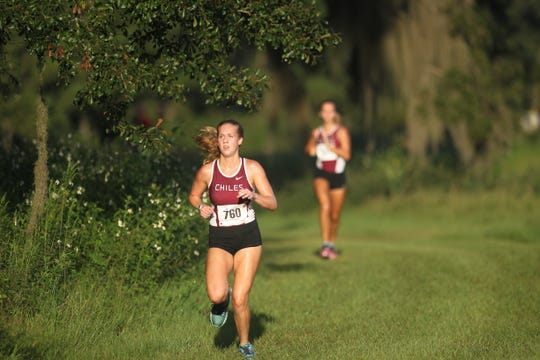 Chiles' Caitlin Wilkey runs to the finish of the Red Hills Invitational cross country meet at Elinor Klapp-Phipps Park.