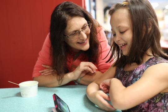 Chloe Novak, 8, was born with a heart defect that caused it to grow too large for her body. The day after her second birthday, she received a heart transplant. Doctors told her parents that she had a slim chance of surviving birth, but she has defied the odds ever since. Chloe's mother, Carolyn, plays with her daughter at Lofty Pursuits on Aug. 29, 2018.
