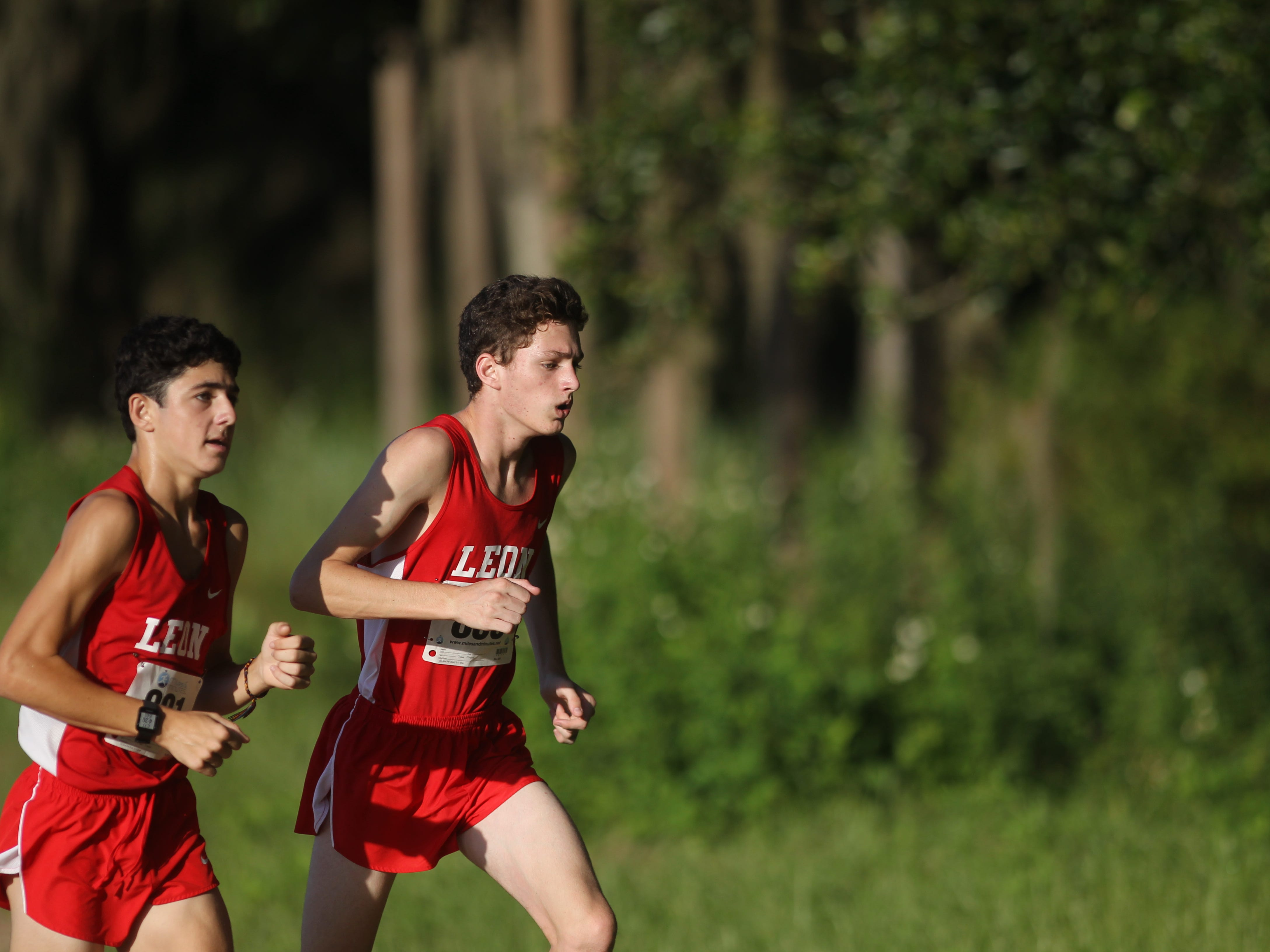 Leon freshman Jackson Yabrough teams a teammate into the woods during the Red Hills Invitational cross country at Elinor Klapp-Phipps Park.