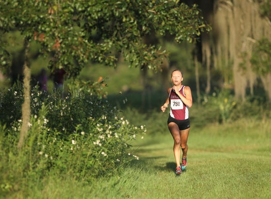 Chiles' Abby Schrobilgen runs to a win at the Red Hills Invitational cross country meet at Elinor Klapp-Phipps Park.