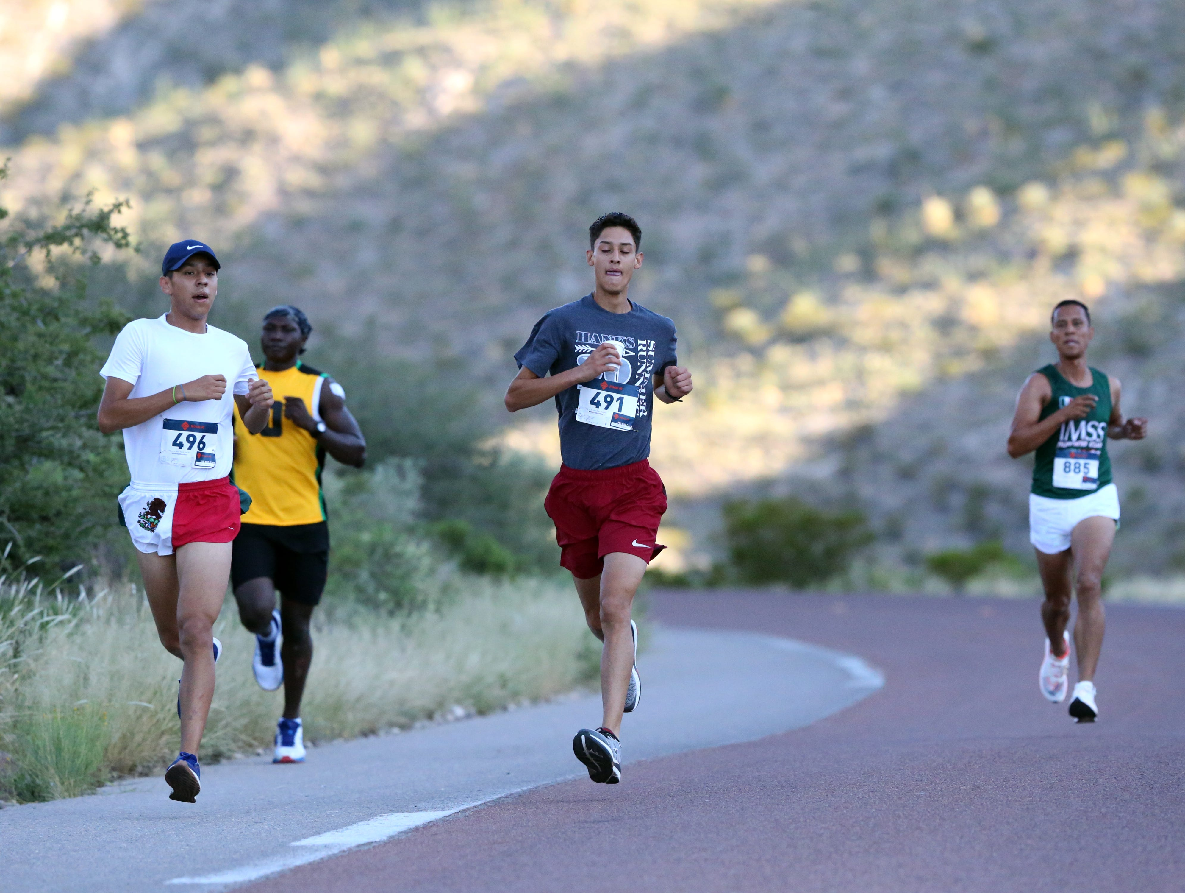 Lead runners race along McKelligon Canyon Road Sunday.