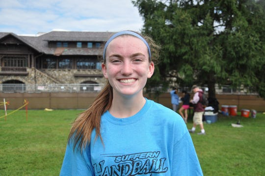 Suffern's Mary Hennelly after winning the Suffern Invitational girls varsity A race.