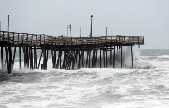 The waves hit the Avalon Fishing Pier in Kill Devil Hills, North Carolina on Friday, September 14, 2018.