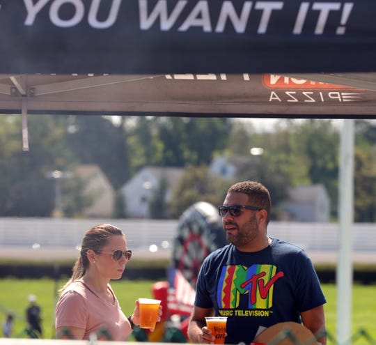 People attend the second annual Food Truck Mash-Up at Empire City Casino in Yonkers Sept.16, 2018.