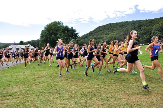 Carmel's Katie Turke (far right) is one of the early leaders in the girls varsity B race at the 2018 Suffern Invitational at Bear Mountain. Turk finished eighth out of 115 runners in the race.