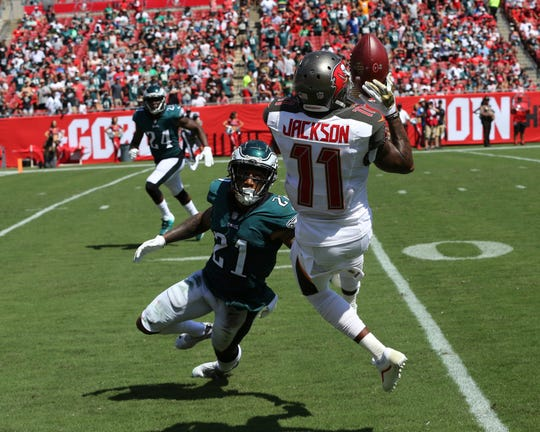 Then Tampa Bay Buccaneers wide receiver DeSean Jackson (11) grabs a pass over Philadelphia Eagles cornerback Ronald Darby (21), during the second half of a game, Sunday, Sept. 16, 2018.
