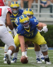 Delaware center Collin Wallish gets set to snap to Pat Kehoe in the first quarter at Delaware Stadium Saturday.