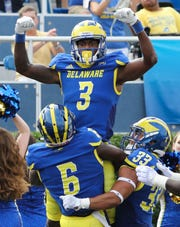 Delaware receiver Joe Walker celebrates after his catch gave the Hens a 7-3 in the first quarter against Cornell at Delaware Stadium Saturday.
