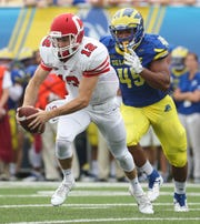 Delaware linebacker Armen Ware pursues Cornell's Mike Catanese before sacking him in the second quarter at Delaware Stadium Saturday.