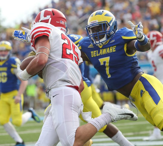 Delaware's Ray Jones (7) moves for Cornell's SK Howard in the second quarter at Delaware Stadium Saturday.