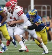 Delaware's Caleb Ashworth tracks down Cornell quarterback Dalton Banks in the second quarter at Delaware Stadium Saturday.