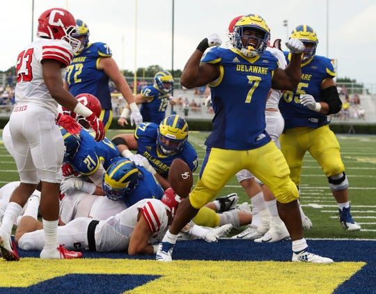 Delaware's Kani Kane celebrates after scoring on a three-yard run in the fourth quarter of the Blue Hens' 27-10 win at Delaware Stadium Saturday.