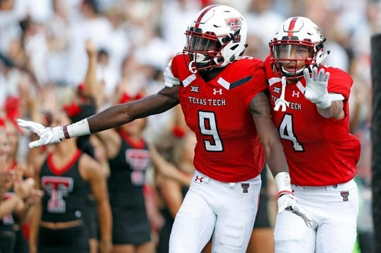 exas Tech's T.J. Vasher (9) celebrates with Antoine Wesley (4) after scoring one of his two touchdowns on Saturday against Houston.