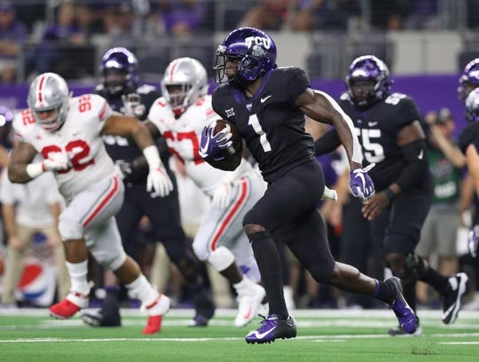 Horned Frogs receiver Jalen Reagor (1) runs with the ball on a reverse in the first quarter against the Ohio State Buckeyes at AT&T Stadium.
