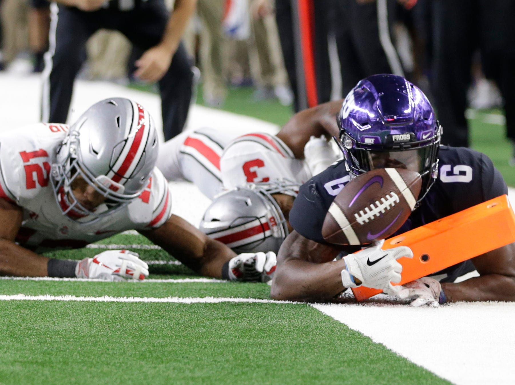 TCU Horned Frogs running back Darius Anderson (6) scores a touchdown against Ohio State Buckeyes cornerback Damon Arnette Jr. (3) in the third quarter at AT&T Stadium.