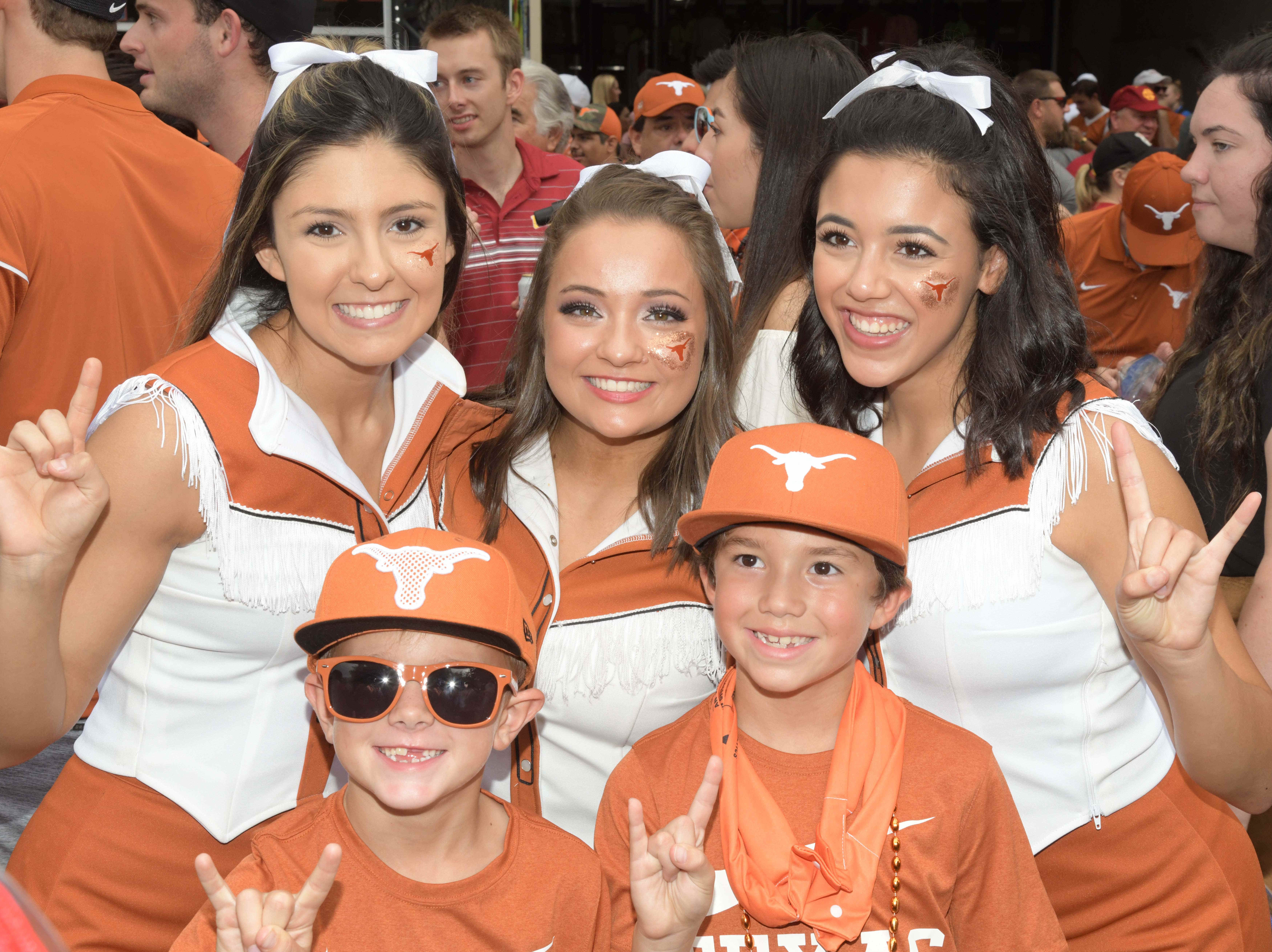 Week 3: Texas Longhorns cheerleaders pose with fans before the game against the Southern California Trojans at Darrell K Royal-Texas Memorial Stadium.