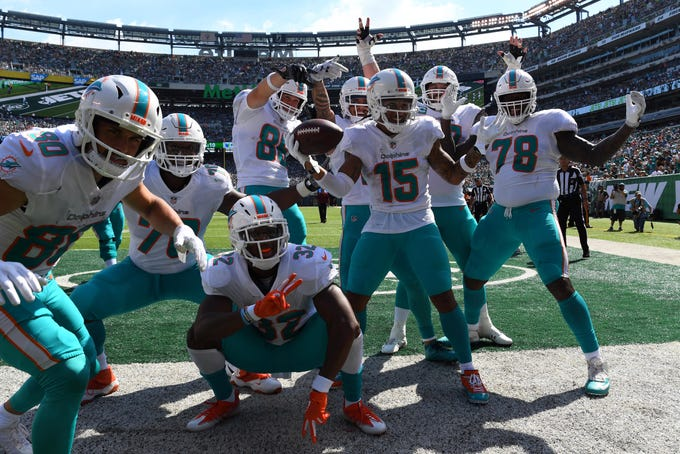 Miami Dolphins wide receiver Albert Wilson celebrates with his teammates after a touchdown reception in the first half against the New York Jets at MetLife Stadium.