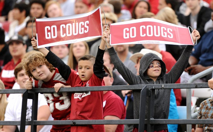 Week 3: A couple of Washington State Cougars fans look on during a game against the Eastern Washington Eagles in the first half at Martin Stadium.